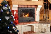 foto of cozy hearth  - Christmas tree and boxes with gifts for family fireplace background - JPG