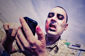 pic of scary  - a scary zombie using a smartphone - JPG