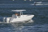 stock photo of outboard engine  - twin outboard engine powered small fishing boat cruising the florida intra - JPG