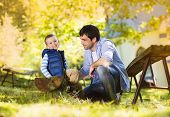 image of father time  - Father and son spending time together in summer nature - JPG