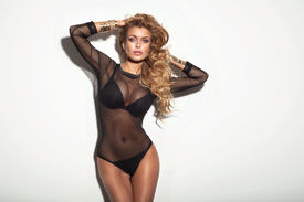 picture of slim model  - Sexy attractive blonde woman with perfect slim body posing in black lingerie looking at camera - JPG