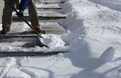 image of shovel  - Man shoveling the show on  bright winter day - JPG