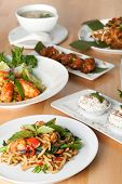 stock photo of thai food  - Varieties of Thai foods and appetizers covering a table - JPG