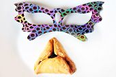 stock photo of purim  - Mask with Hamantaschen cookies pastry is Ashkenazi Jewish cuisine traditionally eaten during the Jewish holiday of Purim - JPG