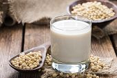 stock photo of milk  - Glass with Soy Milk and Seeds on wooden background - JPG