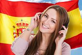 image of citizenship  - Woman Listening Spanish Learning Audiobook In Front Of Spanish Flag - JPG