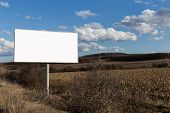 picture of oblong  - Big oblong billboard in fileds next to the road - JPG