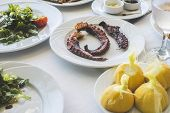 stock photo of piraeus  - Octopus in a Greek restaurant - JPG