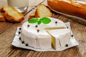 stock photo of baguette  - French traditional camembert cheese with baguette on wood table - JPG