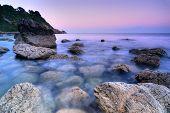 foto of ireland  - Sunset over rocky shore in Howth Peninsula Republic of Ireland Europe - JPG