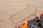 picture of larnaca  - Larnaca pointer and beach accessories lying on the sand as background - JPG
