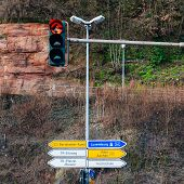 stock photo of koln  - Street sign with arrows to Luxembourg Koln Aachen and High School  - JPG