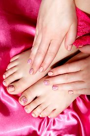 image of painted toes  - Beautiful Manicured and pedicured gel polished nails and toes - JPG