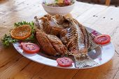 pic of bass fish  - Fish sauce fried sea bass in plate on wood table