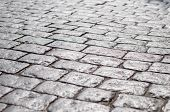 stock photo of cobblestone  - Abstract background of old cobblestone pavement under sunlight - JPG
