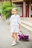 picture of little school girl  - Cute little girl of 7 years girl walking to school - JPG