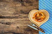 foto of pretzels  - Oktoberfest festival background with pretzel on cutting board - JPG