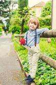 foto of suspenders  - Outdoor portrait of a cute little boy wearing trousers with suspenders - JPG