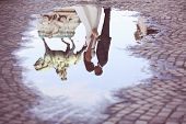 stock photo of paved road  - Bride and groom reflected in slop on paved road - JPG