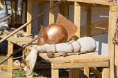 stock photo of spears  - gladiator helmet sword and spear on a wooden bench - JPG