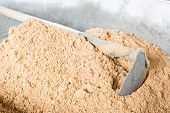 foto of concrete pouring  - Pick up a shovel cement concrete mix is compacted sand - JPG