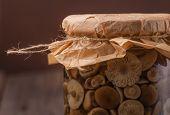 image of marinade  - Marinaded mushrooms in a glass jar on wooden table - JPG