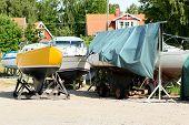 stock photo of tarp  - Boats still on dry land in summer - JPG