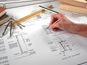 foto of mechanical drawing  - an architects and his workspace with blueprints - JPG