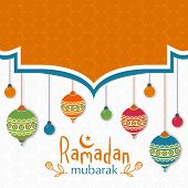 stock photo of ramadan mubarak card  - Beautiful greeting card with colorful hanging traditional lanterns and lights on seamless floral design decorated background for Islamic holy month - JPG