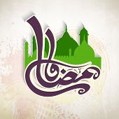 image of ramadan calligraphy  - Arabic Islamic calligraphy of text Ramadan Kareem in front of a green mosque on grungy background for holy month of Muslim community - JPG