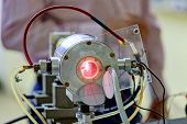 picture of laser beam  - Red laser on optical table in physics laboratory - JPG