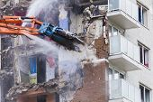 picture of deprivation  - Construction work demolishing high rise flats signifying housing and regeneration - JPG
