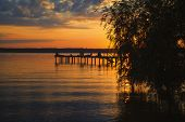 pic of jetties  - Reflections and jetty at Lake Starnberg  in the evening light - JPG