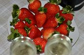 foto of champagne glasses  - Strawberries with champagne and two glasses of champagne - JPG