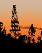 stock photo of fire-station  - Silhouette of tall forest fire watch tower - JPG