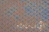 picture of floor covering  - Rust metal cover of drain water on the floor of pavement use as background or texture - JPG