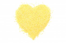 foto of millet  - Heart shaped yellow millet groats valentine heart of millet groats - JPG