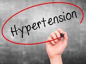 pic of hypertensive  - Man Hand writing Hypertension with black marker on visual screen - JPG