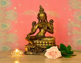 stock photo of compassion  - Indian statue of compassion and a beautiful rose - JPG