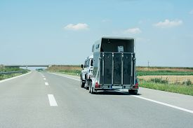 picture of carriage horse  - Off road vehicle with carriage for horses on the high way - JPG