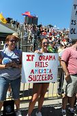 SAINT LOUIS, MISSOURI - SEPTEMBER 12: Young woman holding sign at rally of the Tea Party Patriots in