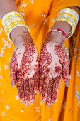 indian woman hands with henna