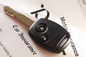 image of car keys  - Car key on an insurance policy - JPG