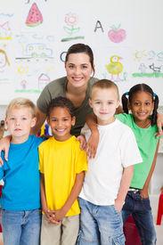 picture of student teacher  - group of preschool kids and teacher in classroom - JPG