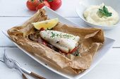 Cod Fillets Baked In Parchment Paper With Vegetables. poster