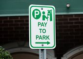 Sign Says That You Must Pay To Park poster