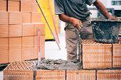 Masonry Details, Industrial Brick Mason, Bricklayer Working On Building Exterior Walls At Constructi poster