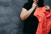 Overweight, Low Self-esteem, Body Shaming. Obese Shy Woman Hesitating To Wear Vibrant Colored Shirt poster