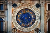 Clock with horoscope in historical buildings at Piazza San Marco in Venice, Italy. poster