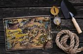 Treasure Map, Compass, Shovel, Mignifying Glass And Rope On Old Wooden Table Background. Treasure Hu poster